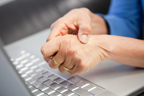 Laptop and woman with pain in hand